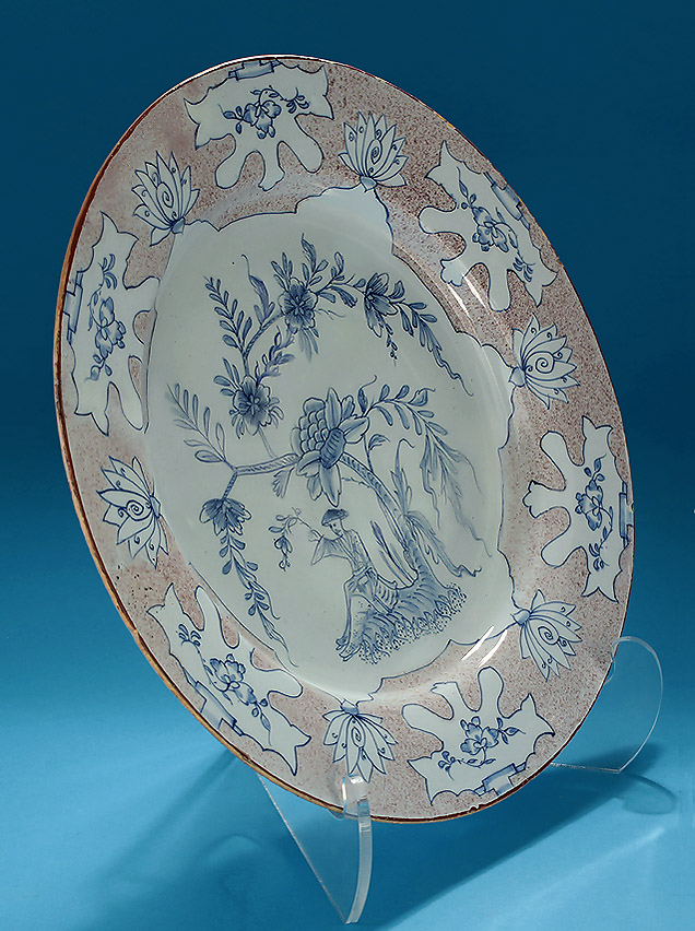 "ENGLISH DELFT MANGANESE & BLUE ""WOOLSACK"" CHARGER, probably Liverpool, c1745-55, oblique left"