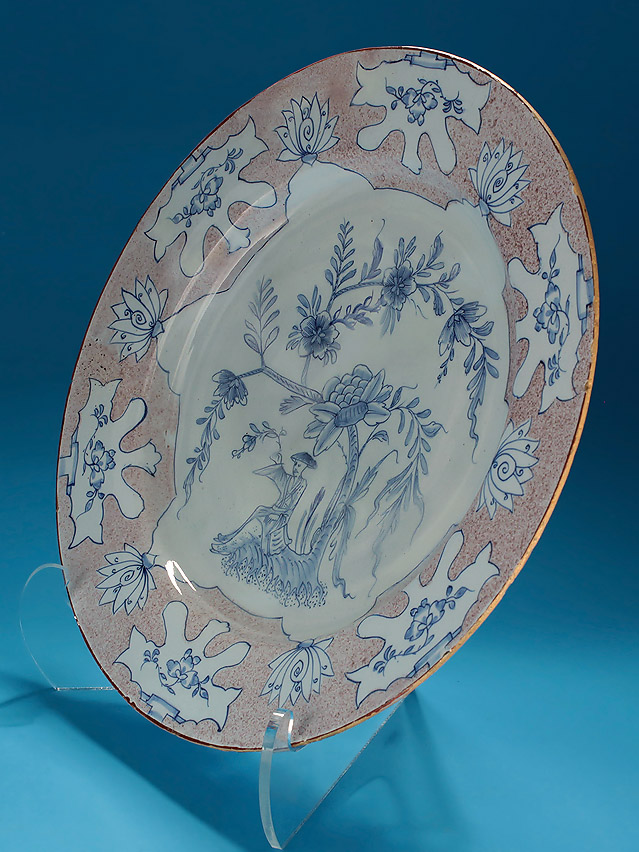 "ENGLISH DELFT MANGANESE & BLUE ""WOOLSACK"" CHARGER, probably Liverpool, c1745-55, oblique right"